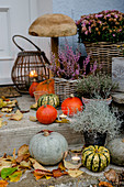Autumn decoration at the house entrance, wooden mushroom as decoration