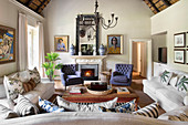 Sofa combination in living room with thatched gable ceiling in renovated farmhouse