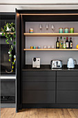 Charcoal-grey kitchen cabinet element with pocket doors