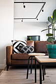 Brown leather couch in seating area on platform