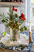 Wintry bouquet with branches and amaryllis on table