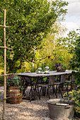 Rustic garden table handmade from boards and old sewing machine bases
