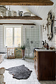 Wooden ceiling beams in large white bathroom decorated in vintage style