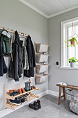 Open cloakroom in hallway with pale grey walls