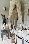 Antique bed with canopy in child's bedroom