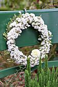 White wreath of sea lavender, dahlia and common heather