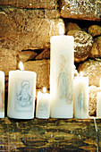 Candles decorated with Christian motifs for Easter festival