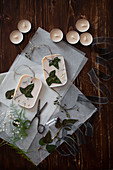 Handmade scented wax tablets with ivy leaves lying on tissue paper