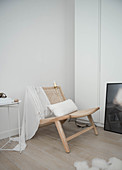 Wooden chair with cane seat and backrest in corner