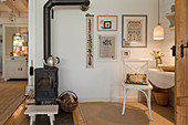 Wood-burning stove in cosy, country-house-style interior