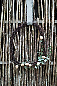 Wreath of birch twigs, wooden eggs and eucalyptus branches