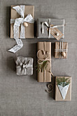 Gifts wrapped in vintage-style in shades of grey and beige