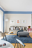 Blue living room with various grey seating