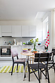 White kitchen decorated with sophisticated splashes of colour and geometric patterns