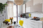 Beige kitchen counter and matching wall units in bright kitchen