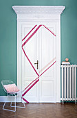 White panelled door decorated with hot-pink washi tape