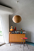 Retro drinks cabinet in living room with organically formed walls