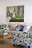 Blue-and-white armchair and ecru sofa in living room