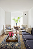 Upholstered furnishings in blue and ecru in white living room