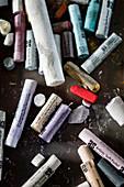Colourful chalks on table