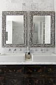 Mirrors inlaid with mother-of-pearl above twin sinks