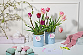 Easter arrangement of tulips in upcycled tin cans with printed tags