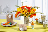 Vase of tulips and DIY Easter gift bags