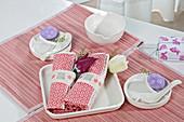 Linen napkins in DIY napkin ring on table set for Easter breakfast