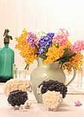 DIY Easter lambs in front of jug of hyacinths