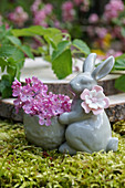 Easter bunny with lilac flowers