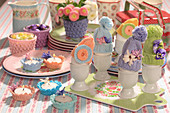 Bobble-hat egg warmers and crocheted tealight holders on Easter table