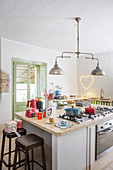 Gas cooker in island counter in simple country-house kitchen