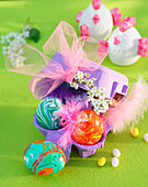 Marbled Easter eggs in egg box decorated with feathers and net bow