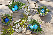 Blue-marbled Easter eggs in nests of grass and willow twigs