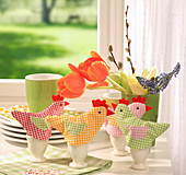 Hen-shaped egg warmers made from gingham fabrics for Easter breakfast