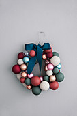 DIY wreath made from coat hanger and baubles