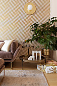 Patterned wallpaper in living room decorated in gold and mauve at Christmas