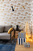 Gifts in striped boxes and wallpaper with palm-leaf pattern in living room