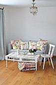 Pallet table, chair and sofa with floral scatter cushions