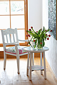 Redesign: chair with floral seat cushion and tulips on round table