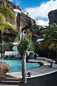 Pool and rock garden of the Villa Lagomar, Lanzarote, built into a cliff