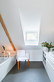 Ensuite bathroom with fitted cabinets in converted attic
