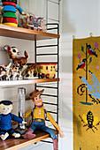 Old toys on String shelves in child's bedroom