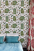 Vintage wallpaper with pattern of exotic objects in bedroom