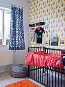 Various retro patterns and cot in nursery