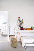 Desk on trestles in teenagers bedroom decorated in white