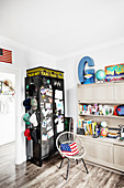 Black locker and American accessories in teenager's bedroom