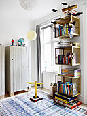 Shelving modules made from gold-painted baskets and wooden wardrobes in children's bedroom