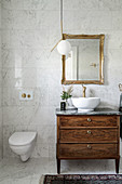 Washstand made from old chest of drawers with countertop sink in bathroom