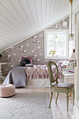 Girl's bedroom in pastel shades with sloping ceiling